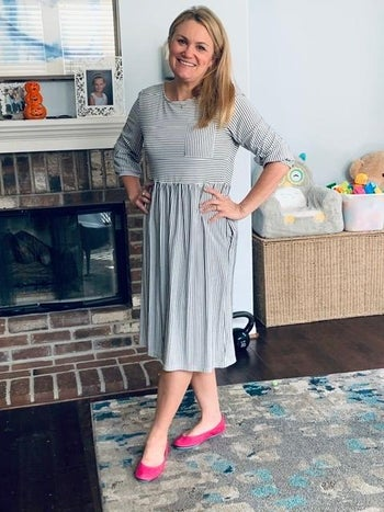 reviewer wearing the black and white striped three quarter sleeve dress