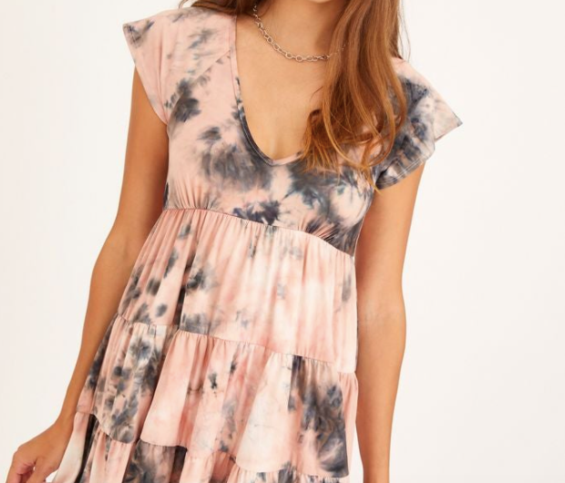 A flowy tie dye dress with a v-neck and short sleeves