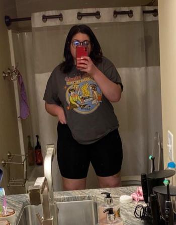 Reviewer in black knee length high waist bike shorts