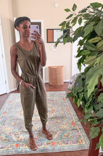 a different reviewer wearing the jumpsuit in green