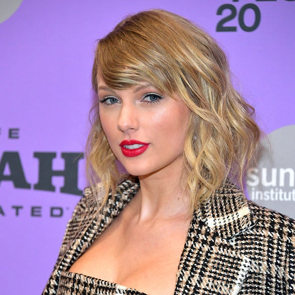 Taylor Swift poses on a red carpet during the Sundance Film Festival.