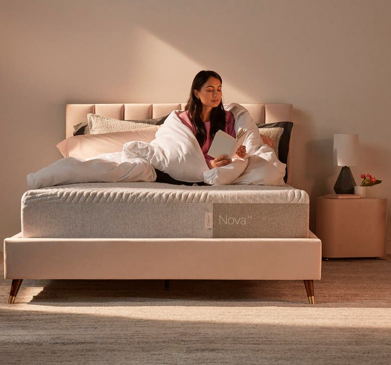 the thick grey mattress with woven design on the top