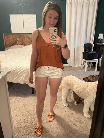 reviewer wearing the rust color version half tucked into shorts