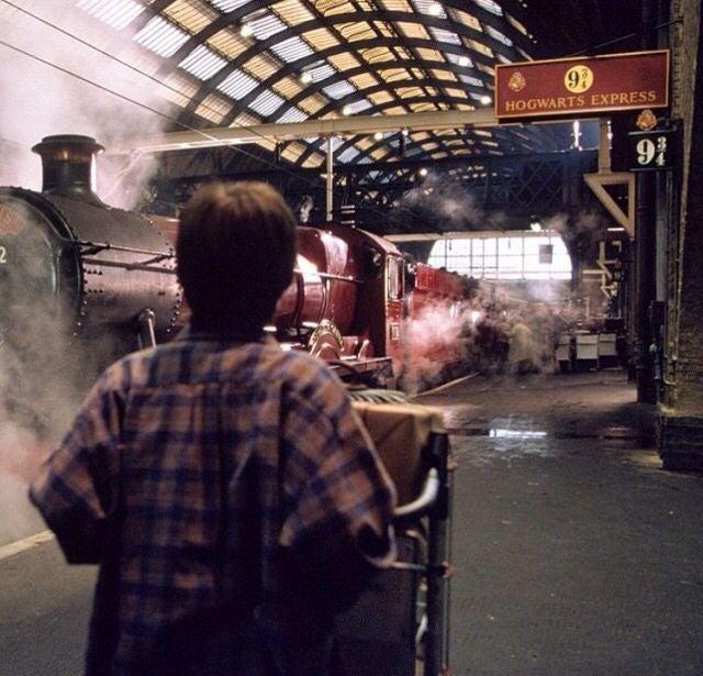 Harry pushes his cart toward the platform