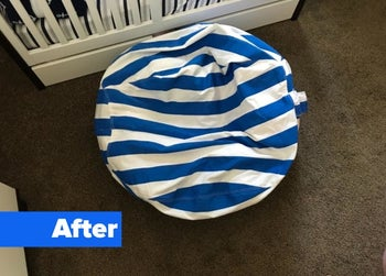 Reviewer's after photo showing  a tidy room with the stuffed animals hidden inside the bean bag cover