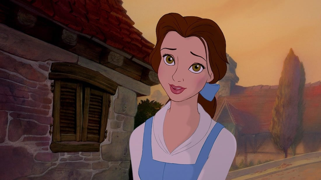 "Belle smiles as she walks around her village in ""Beauty and the Beast"""