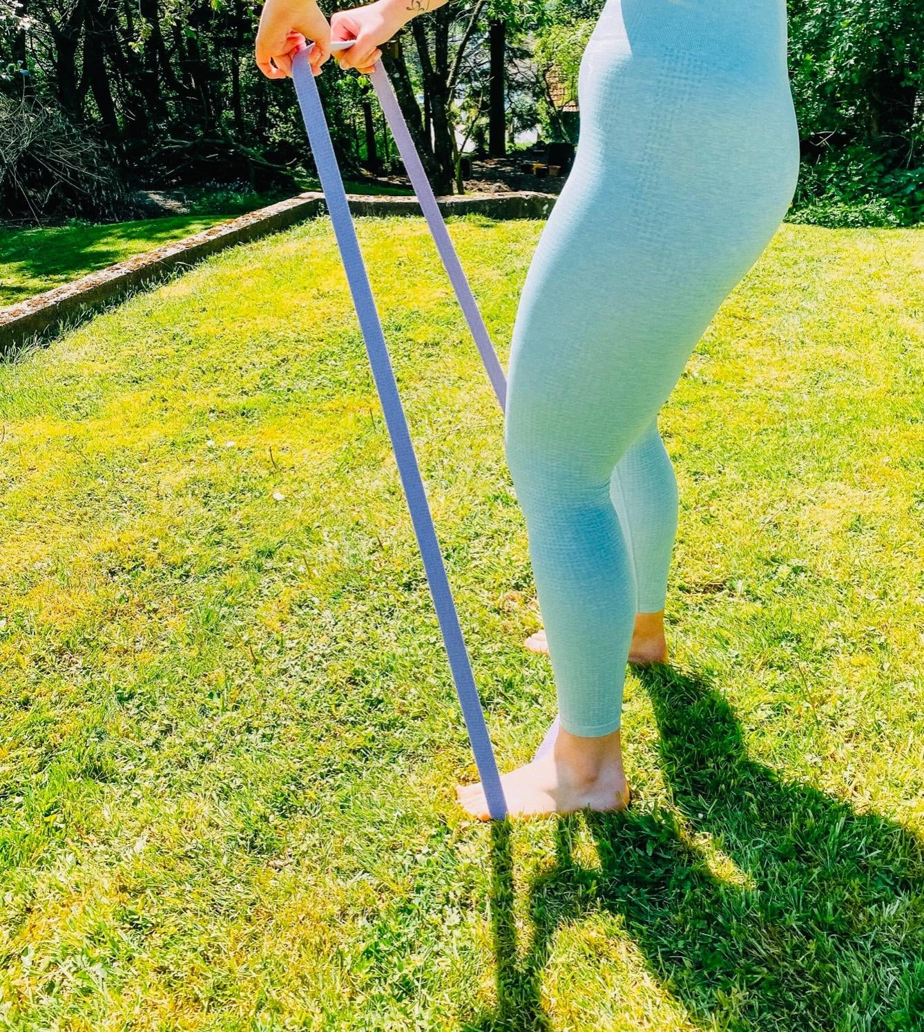 a reviewer photo of someone using the resistance bands