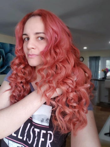 another reviewer showing off their pink hair