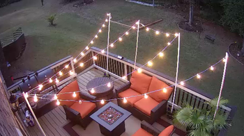 the round bulb string lights over a reviewer's patio