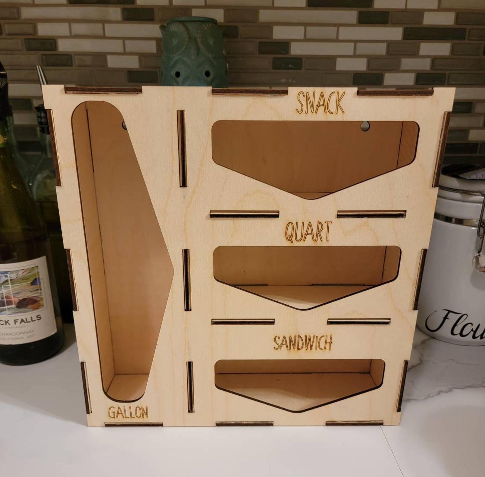 the organizer which has slots for gallon, snack, quart, and sandwich baggies