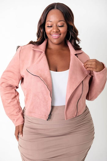front view of a model in the cropped moto jacket
