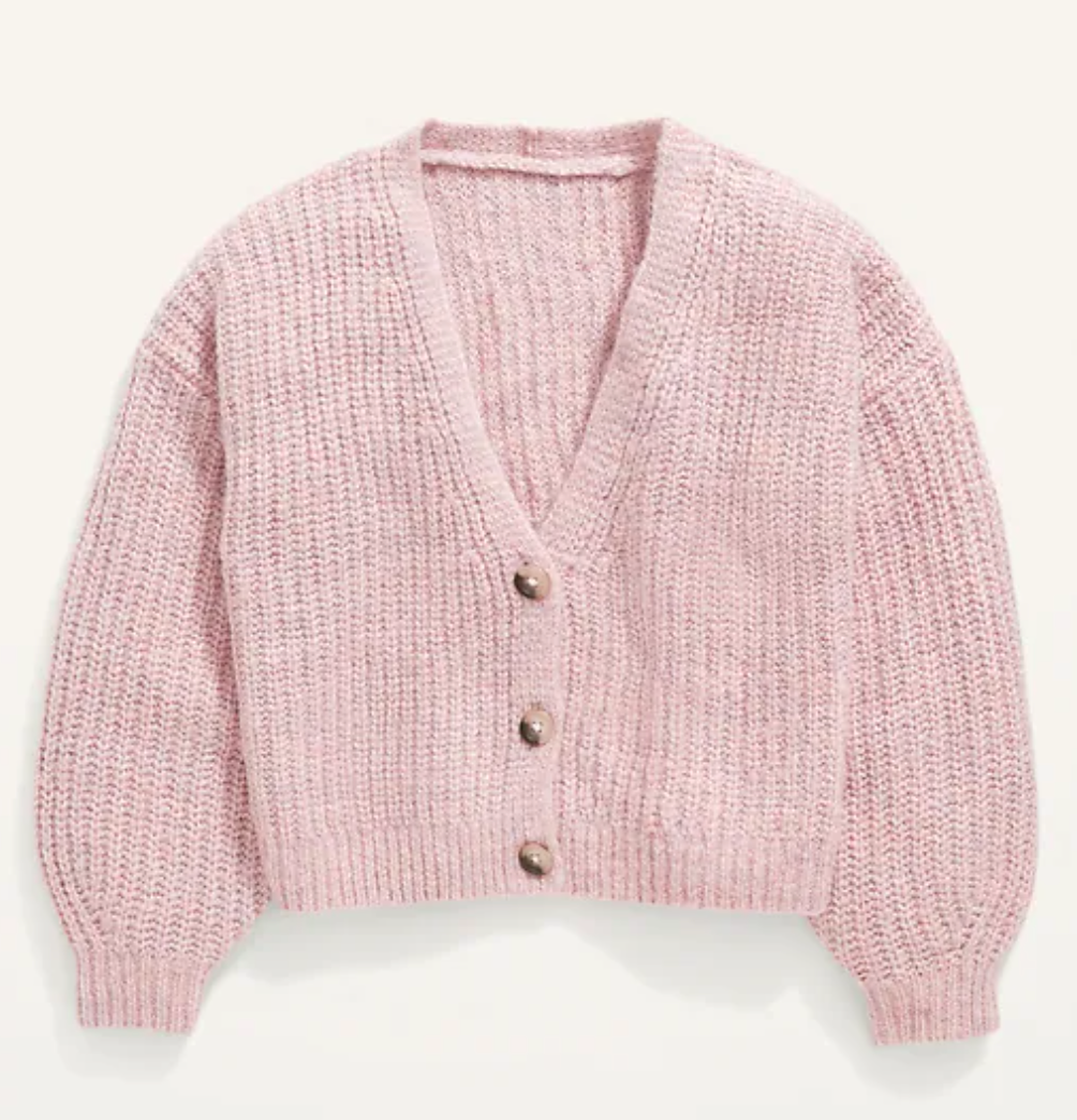 a pink button-down cardigan