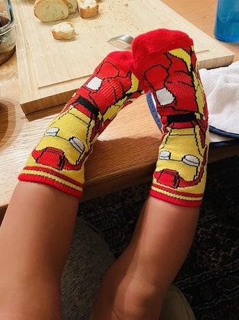 a reviewer's child wearing iron man socks