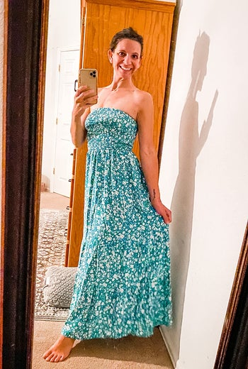 reviewer wears same style dress in a white and green floral print