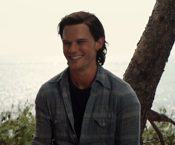 Younger Sam smiling