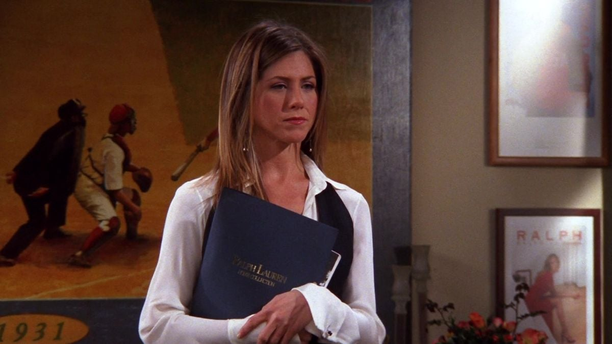Rachel is holding a file close to her chest while looking disturbed