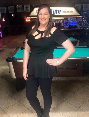 reviewer wearing the top in black