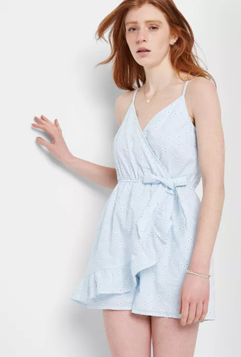 front view of a different model in a light blue romper