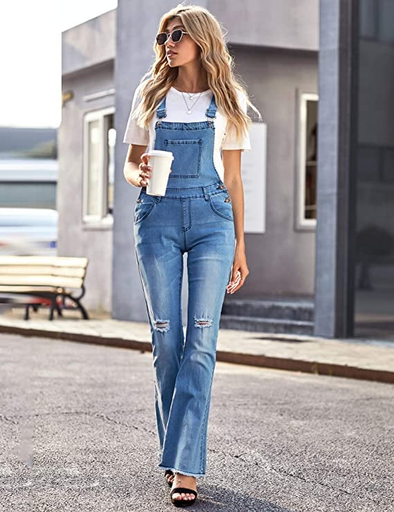 model wearing overalls with flared pant bottoms