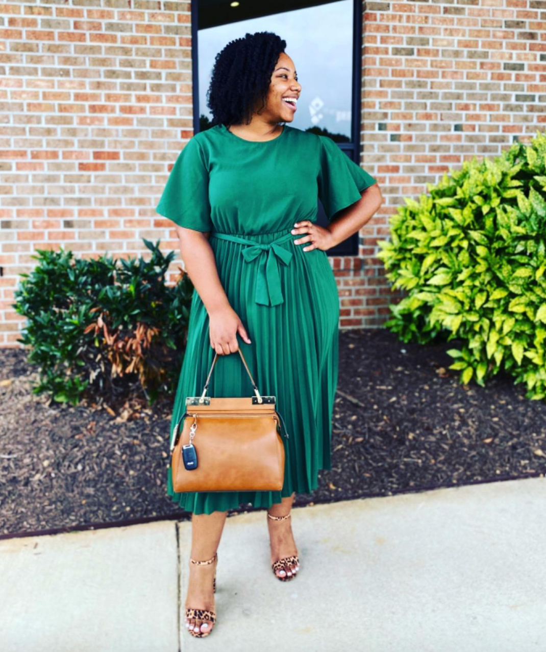 reviewer wearing the green midi dre
