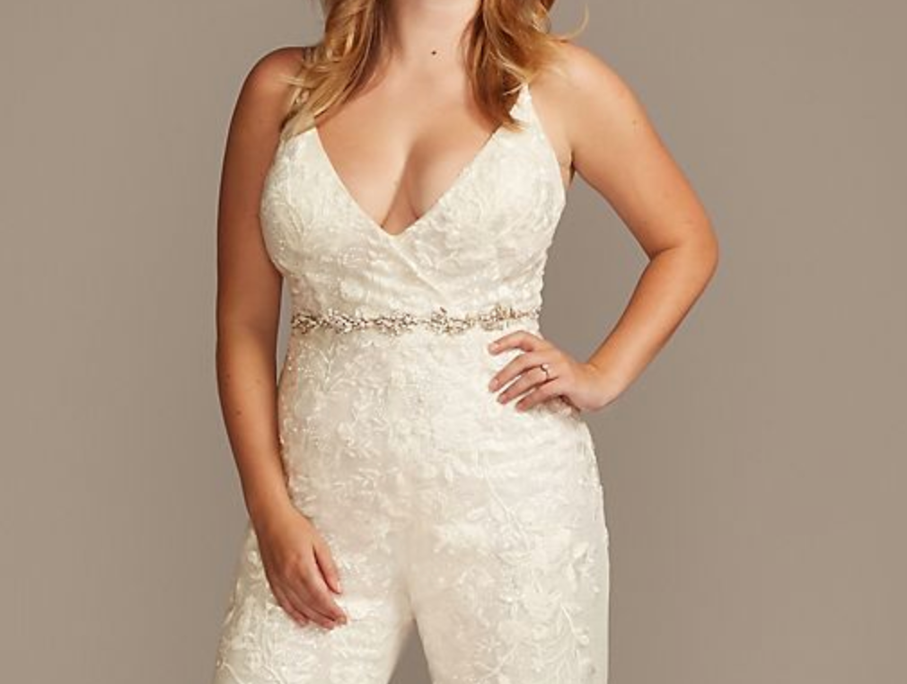 A lacy jumpsuit with thin straps and a belt around the waist