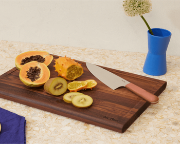 coral version on a cutting board with fruit