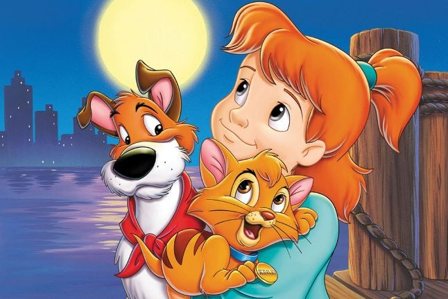 A young girl holds a smiling orange cat while a Jack Russel sits beside her