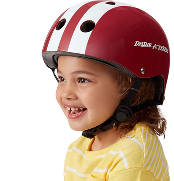 Child model wearing red Radio Flyer helmet with white stripes