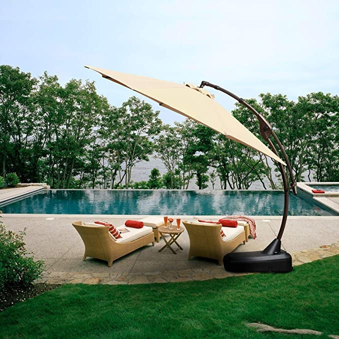 large umbrella opened up next to pool to shade pool chairs