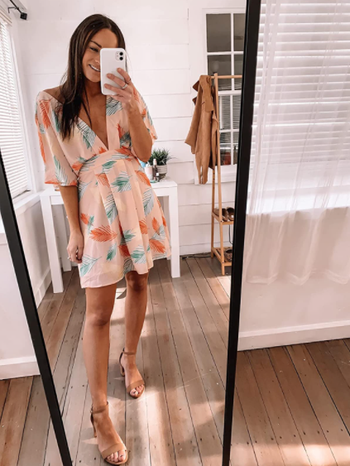 different reviewer wearing dress with nude pumps