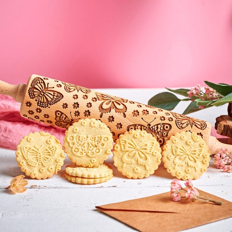 cookies with a butterfly design that was created with the rolling pin