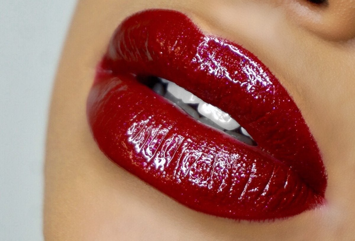 a model wearing a sparkly red lip