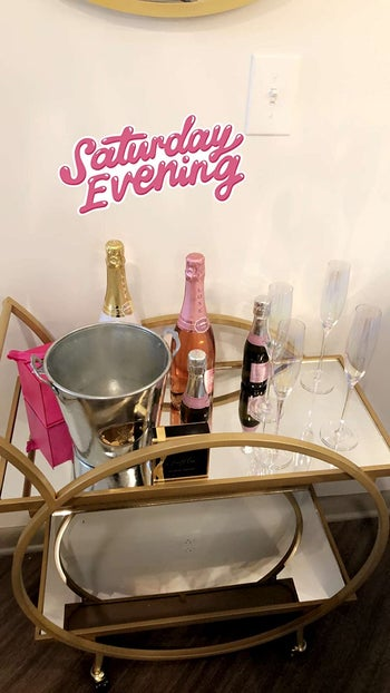 reviewer's cart loaded with wine with Instagram story sticker that says