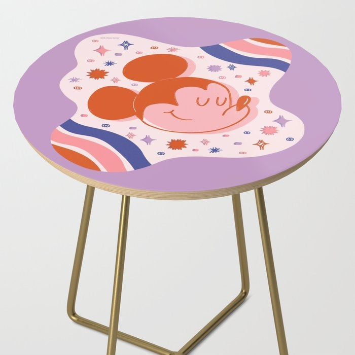 a round end table with a pink galactic mickey table top