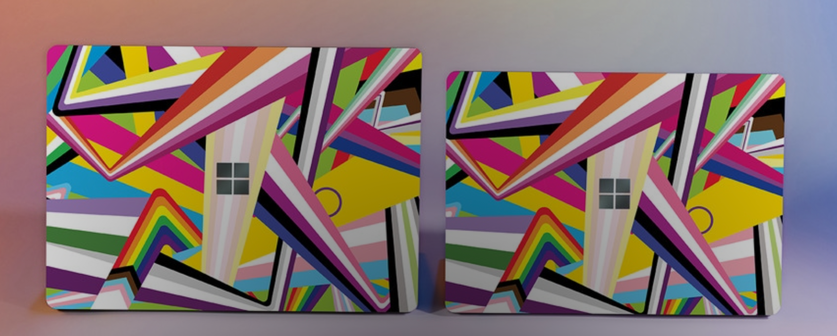 the two sized microsoft laptops with colorful designs on them