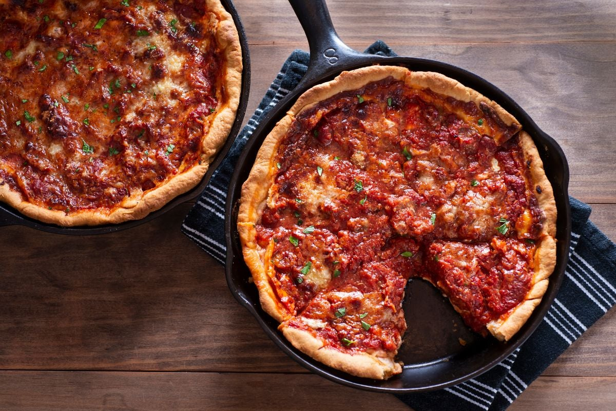 Two deep dish pizzas