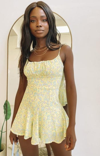 front view of a model in the yellow romper