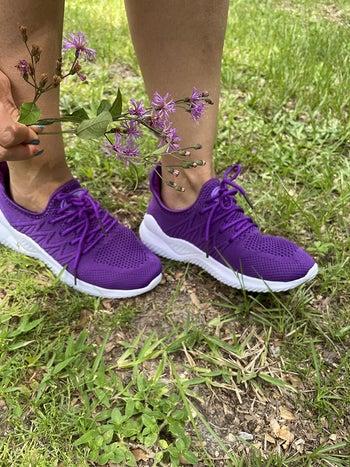 Reviewer wearing purple ZYEN running shoes