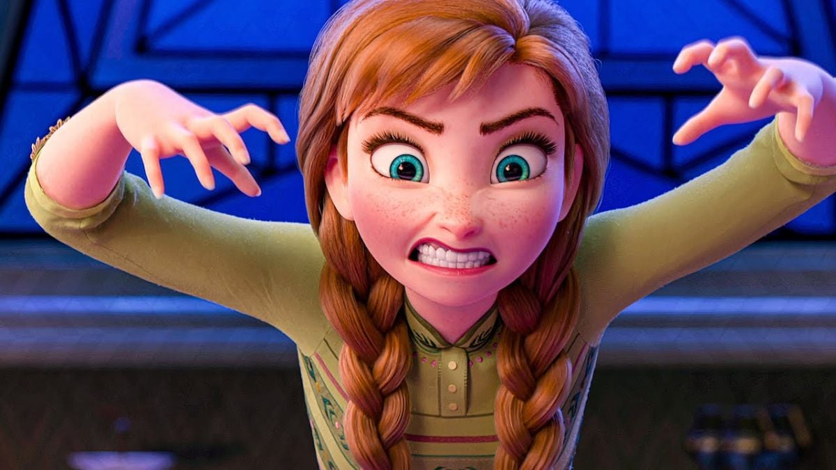 "Anna bares her teeth and mimes claws with her hands while she plays a game of charades in ""Frozen 2"""