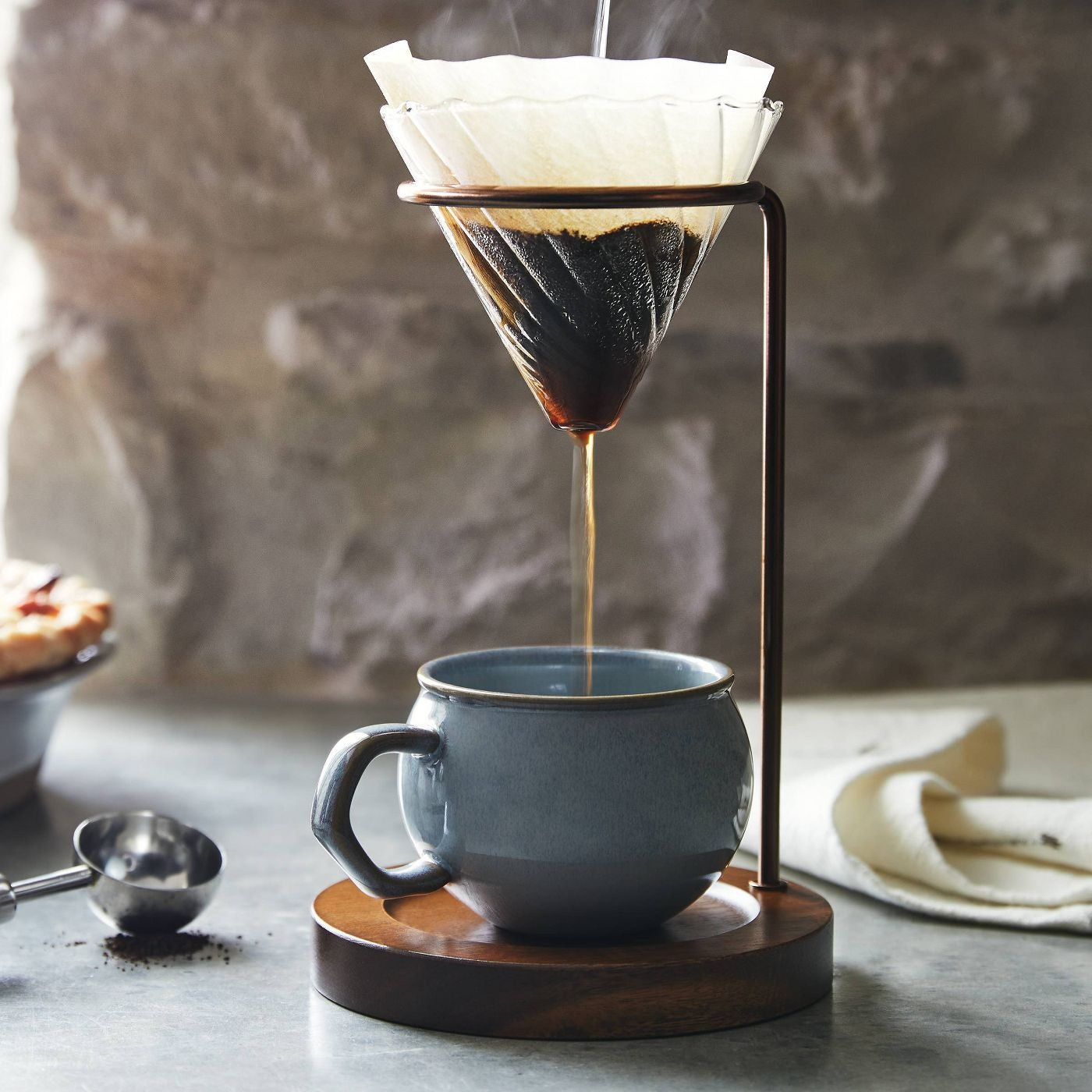 glass pour over coffee maker with metal arm and wood base