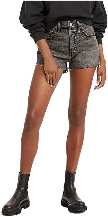 model in the black shorts