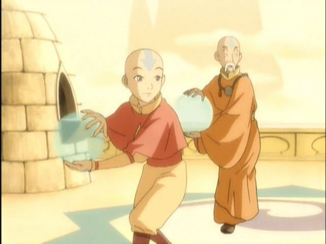 A young boy with an arrow on his head and an old man with a long mustache and an arrow on his head are holding clear, round balls. They both wear pastel-colored robes
