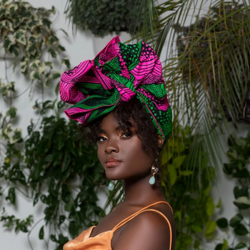 model waring a pink and green head wrap