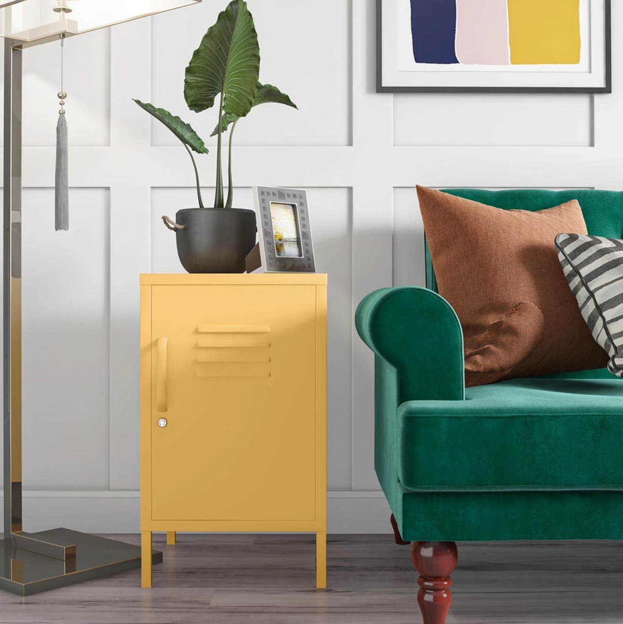 the yellow locker end table next to a couch with a picture frame and plant on top