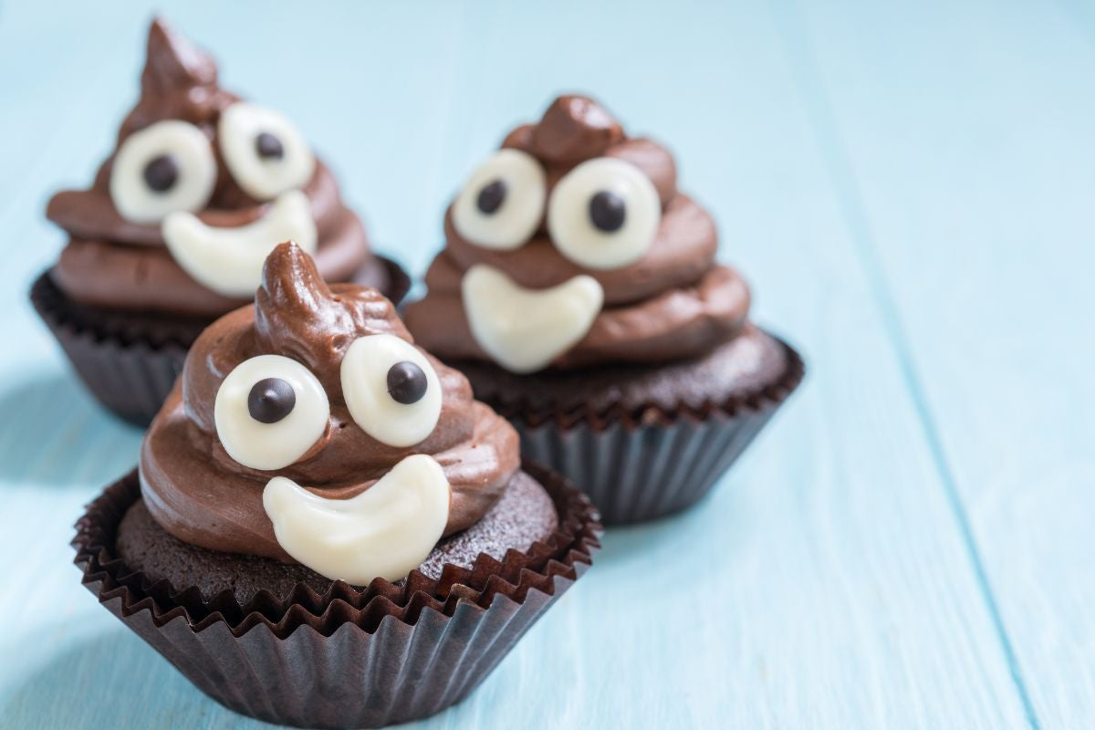 Cupcakes frosted to look like the poop emoji