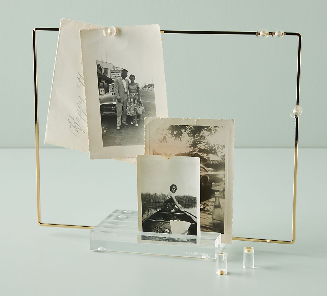 the square acrylic display with cold edge and magnets to hang photos and notes