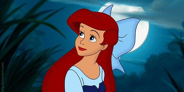 "Ariel sits on a boat in the moonlight in ""The Little Mermaid"""