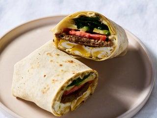 Eggs, sausage, avocado, spinach, and aioli wrap