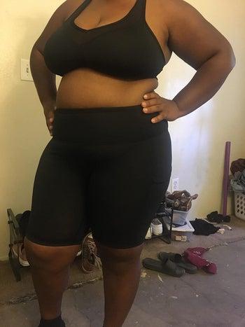 plus-size reviewer wearing the black bike shorts