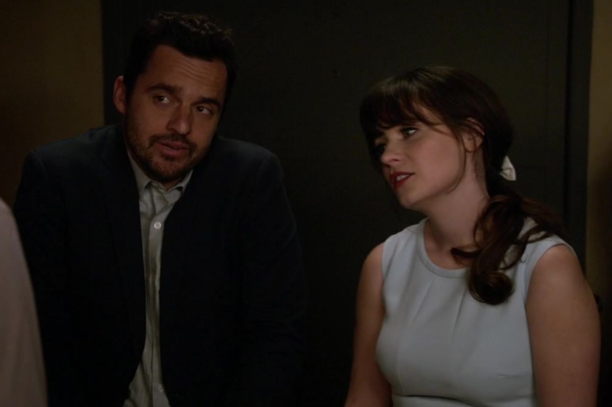"Jake Johnson as Nick Miller and Zoey Deschanel as Jessica Day in the show ""New Girl."""